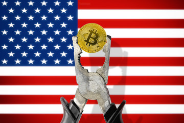 BITCOIN coin being squeezed in vice on the United States (USA) flag background; concept of cryptocurrency bitcoin under pressure. Prohibition of cryptocurrencies, regulations, restrictions or security