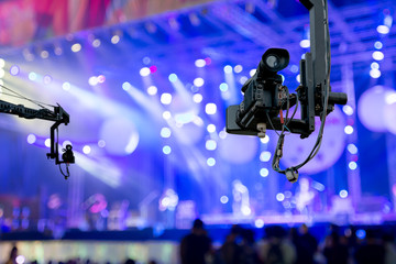 video camera on crane  covering event on stage