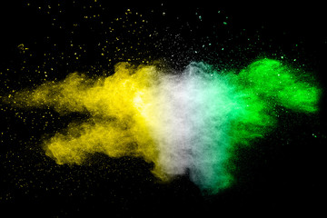 Color Holi powder splattered in Indian festival. Color powder explosion. Flag of India made with colorful powder splash isolated on black background.