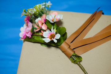 Beautiful romantic gift box and artificial flower bouquet