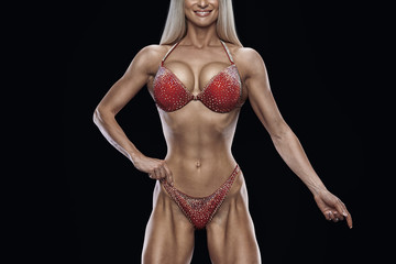 Cropped photo Fitness bikini model well trained body Sports competition female champion stage Athlete bodybuilder posing Perfect strong body trained shape arms abs chest legs Clipping path