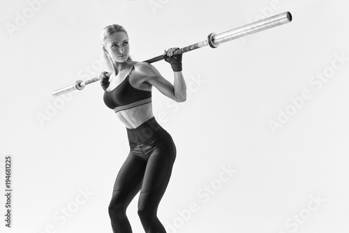 0be90348f8b25 Black and white photo of beautiful strong young woman with barbell and  weight plates Fit young female athlete lifting heavy weights Caucasian  female model ...