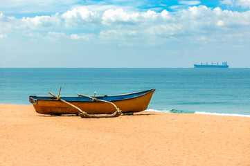 Yellow fishing boat on the shores of the Indian ocean. Goa. India. Vacation holidays travel background wallpaper