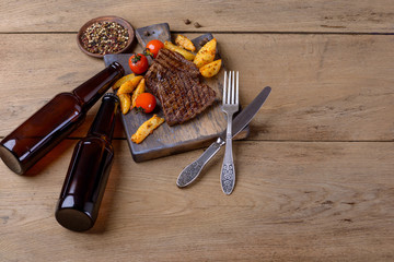 Beer and beef steak with vegetables