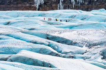 mountaineers hiking a glacier in iceland