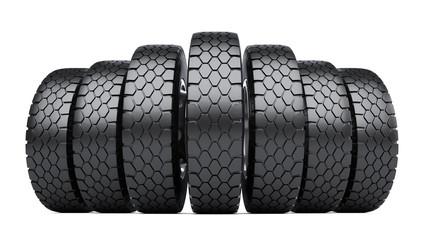 Row of big vehicle truck tires.