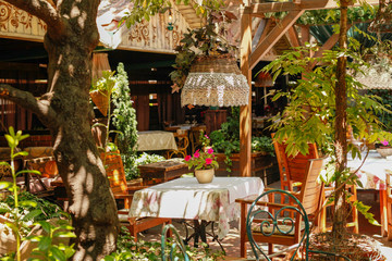 Outdoor tables and sofas in vintage restaurat