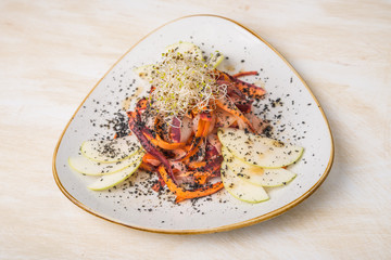 Vegan salad in plate, mixed carrot with apples and sprouts
