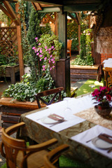 Garden restaurant with setting tables