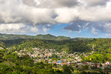 Samana, Dominican Republic. View on the village with colorful houses and palm trees. The sunny and tropical little town with bright buildings.
