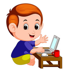 cute boy using laptop computer
