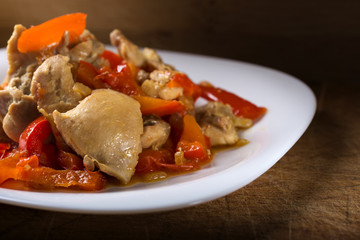 Plate with chicken stew with red pepper