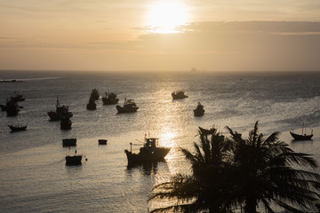 boats sunset in Vietnam