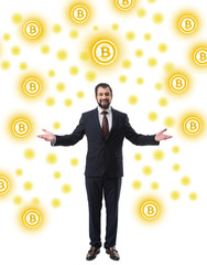 cheerful successful businessman in suit looking at camera, bitcoin symbols isolated on white