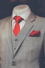 Work in Progress Suit without sleeve on Mannequin red necktie with Dark background