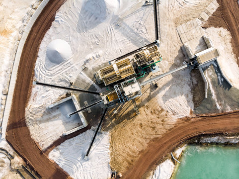 Aerial view of the processing plant with the sand fractionator at the edge of a quartz sand quarry pond for white quartz sand