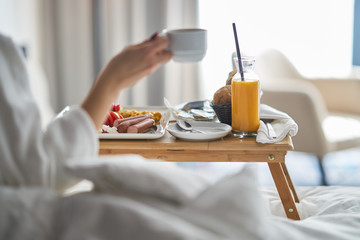 Breakfast in bed, cozy hotel room