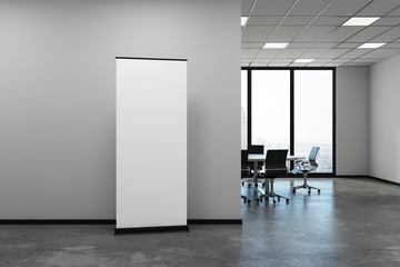 Modern meeting room with blank poster