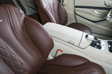 Modern Luxury car inside. Interior of prestige modern car. Comfortable leather seats. Red perforated leather cockpit. Modern car interior details