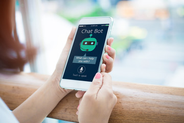 artificial intelligence,AI chat bot concept.close-up of Female hands holding mobile phone