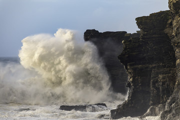 Massive wave crashes back off Horse Rock at Portreath in Cornwall