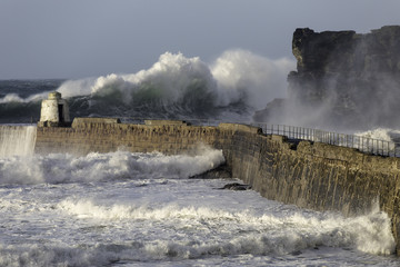 Massive wave towers over the entrance to Portreath harbour in north Cornwall