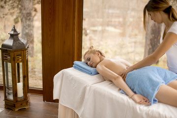 Beautiful blond woman enjoying a massage at the health spa