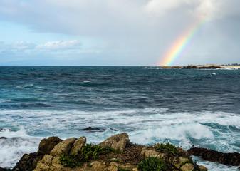 Rainbow over ocean near Pebble beach,Monterey Peninsula, California, USA