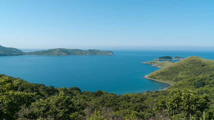 Beautiful blue water bay, crystal clean water, blue sky