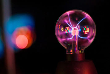 Closeup of an electric energy plasma sphere. Glowing electrostatic ball.