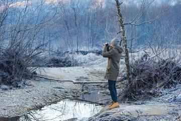 Photographer shoots winter forest