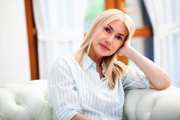 Mature woman relaxing on a sofa