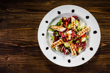 Caesar salad on wooden table