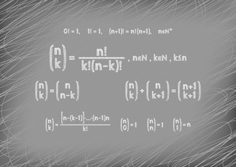 Theorem written by hand on a gray board. The Newton symbol.
