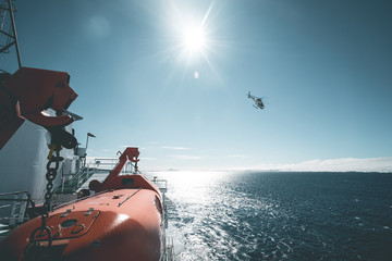 Helicopter departing from Expedition Vessel - Antarctica