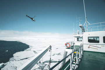 Helicopter flying over Ship - Antarctica