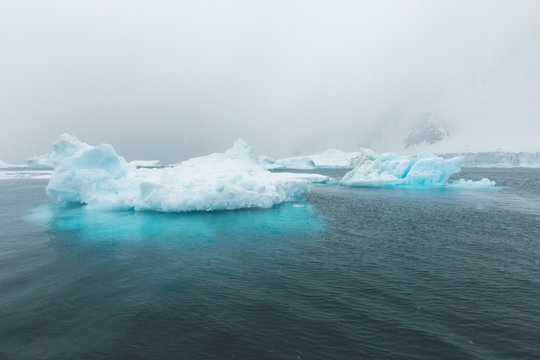 Pointed Ice Bergs tower out of the Ocean - Antarctica