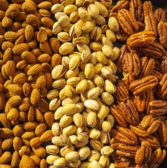 Nuts almonds, pistachios and pecans, close-up, set.