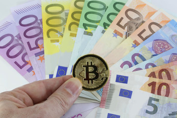 golden bitcoin and background with european banknotes