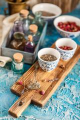 Dry medicinal herbs in bowls.