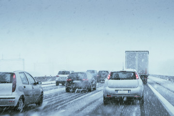 Winter Driving - commuter traffic on a highway during a snowfall