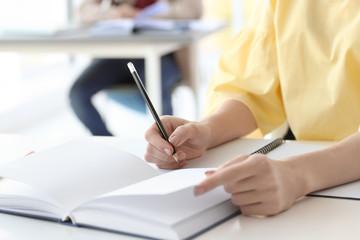 Female student preparing for exam indoors, closeup