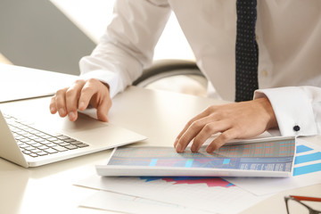 Young man working at table in office. Consulting service concept