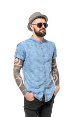 Portrait of handsome hipster in stylish outfit on white background