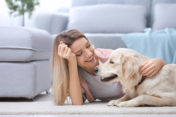 Portrait of happy woman with her dog at home