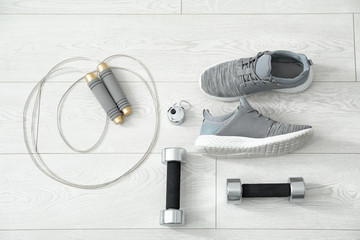 Composition with sport shoes on floor