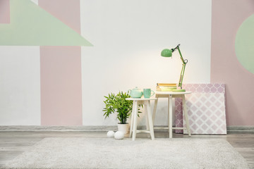 Room interior with houseplant and elegant lamp on table
