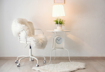 Room interior with comfortable armchair and elegant lamp on table