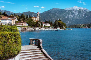 Amazing view of bright blue Como lake, Lombardy Italy, panorama of the lake and the city. Mountains on the background and good sunny summer weather