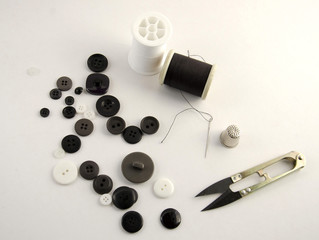 Sewing supplies on a plain background